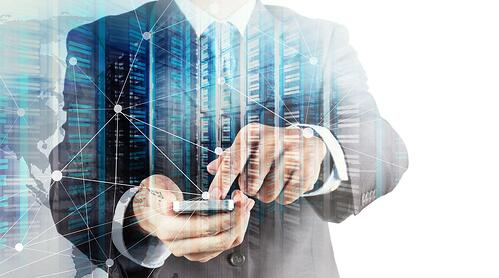 Double exposure of Businessman hand using mobile phone and server room as concept