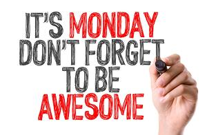 Hand with marker writing Its Monday Don't Forget to be Awesome